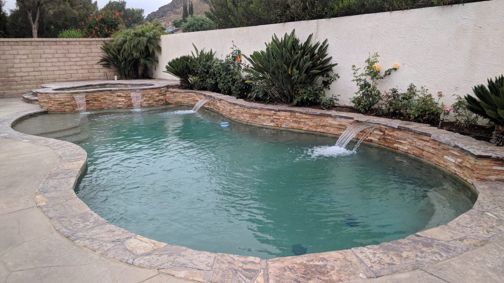 711 Bluebonnet - Pool with waterfall feature on